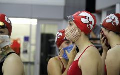 City High swimmers prepare for their events at a dual meet against Linn Mar