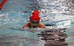 Isabelle Polfliet '23 swims the 100 breaststroke in a dual meet against Waterloo