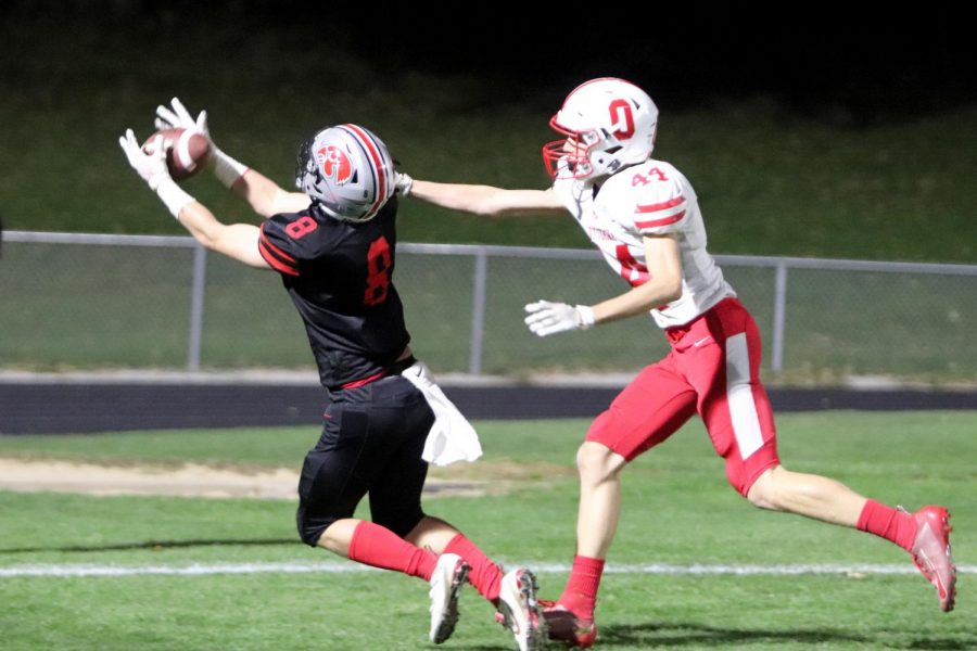 Gable Mitchell hauls in a long touchdown pass in City's victory over Ottumwa 41-16.