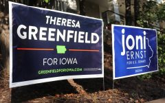 Yard signs in support of Theresa Greenfield and Joni Ernst, candidates for the Iowa Senate