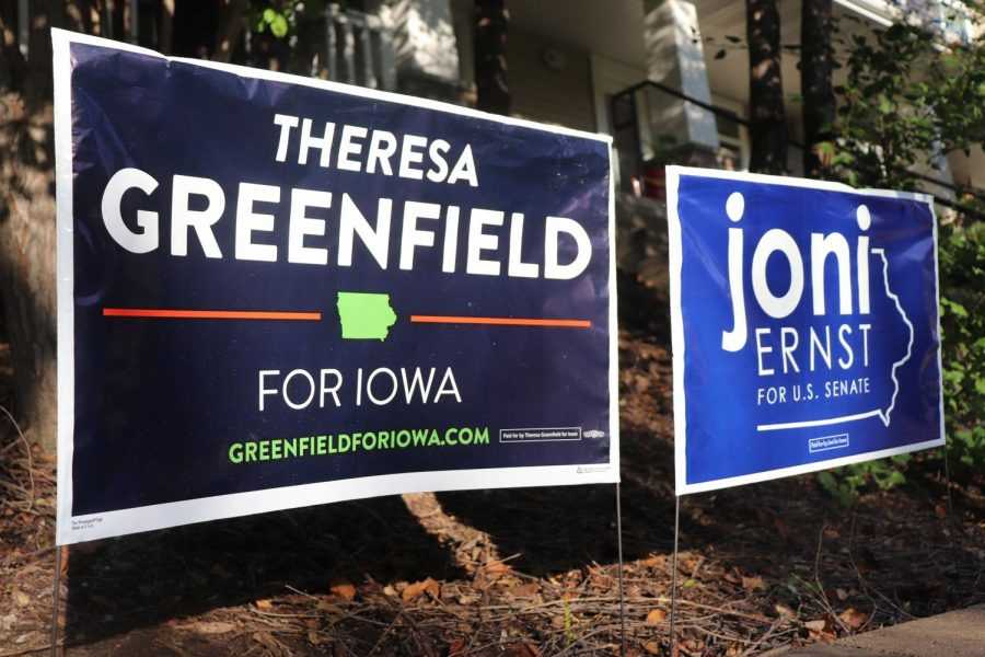 Yard+signs+in+support+of+Theresa+Greenfield+and+Joni+Ernst%2C+candidates+for+the+Iowa+Senate