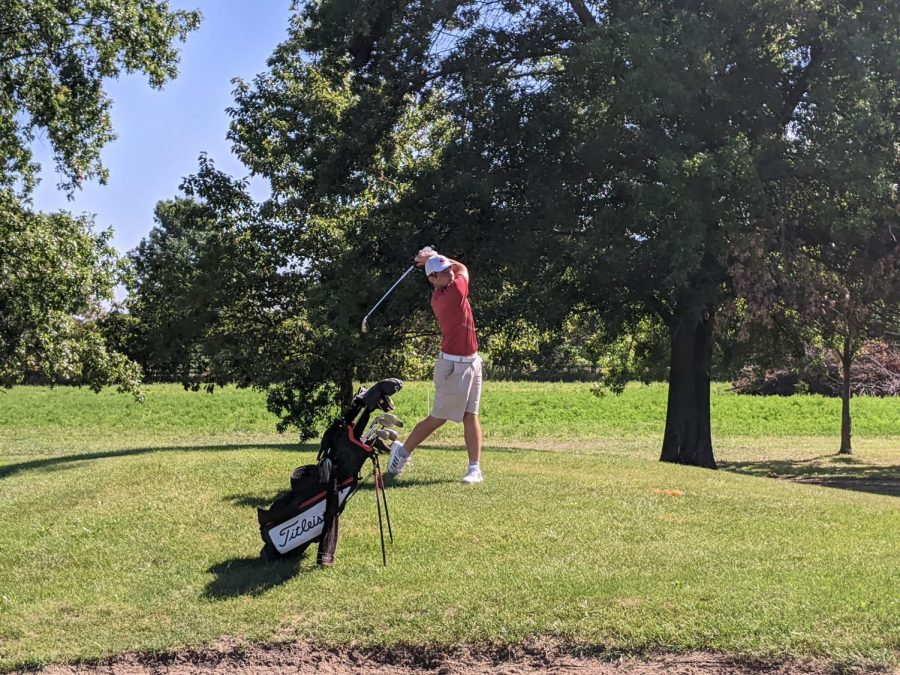 Cooper Kirshling '21 chips in on hole 10 at Pleasant Valley Golf Course.