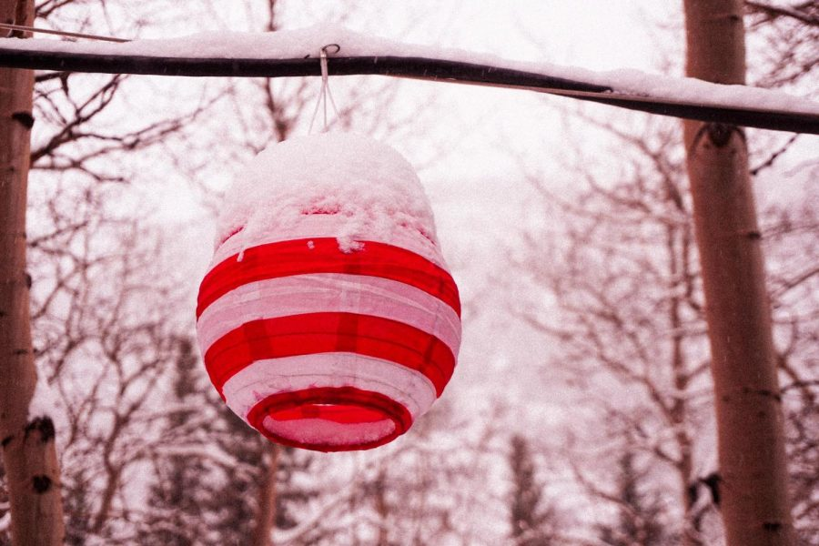 Festive lantern on a snowy afternoon.