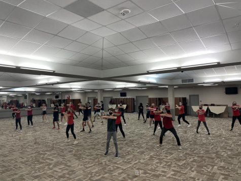 Fourth Ave show choir practicing in the City High cafeteria before the decision to go online.