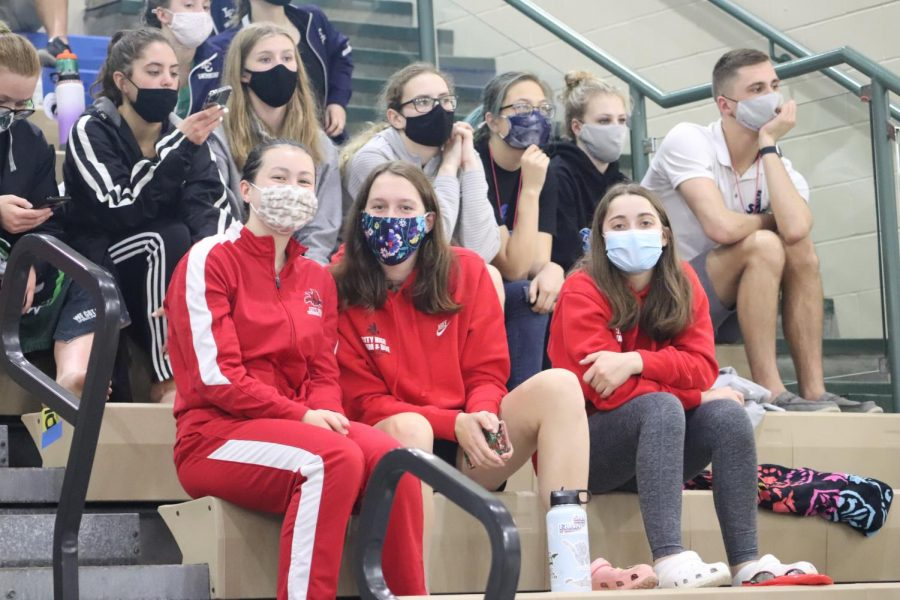 City High swimmers sitting in the stands since no spectators were allowed.