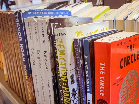 Library cart filled with recently check-out books.