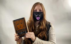 Kate Kueter '21 holds the book Circe by Madeline Miller.