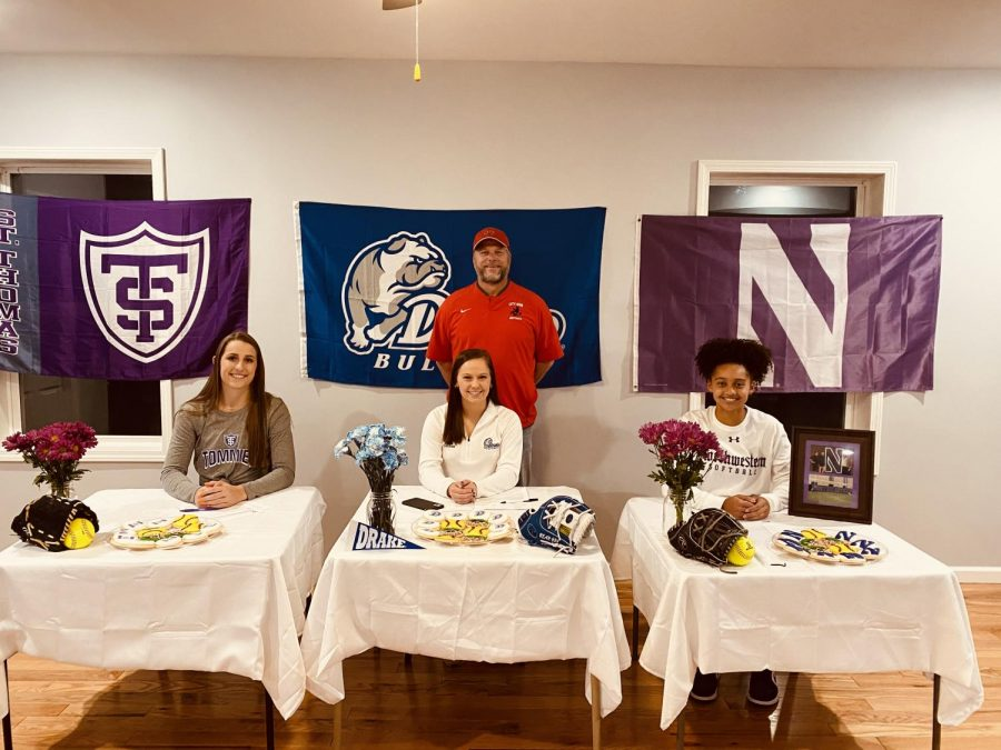 Ella Cook '21, Carey Koenig '21, and Ayana Lindsey '21 smiling after signing letters of intent for their respective colleges.