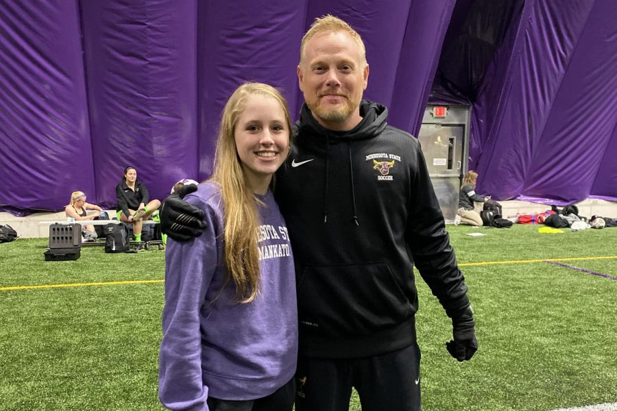 Mia Deprenger '22 posing for a photo with a Minnesota State University soccer coach.