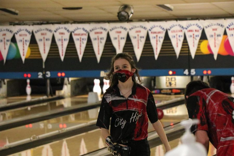 Britney Russell 22' walks towards teammates after bowling a spare.