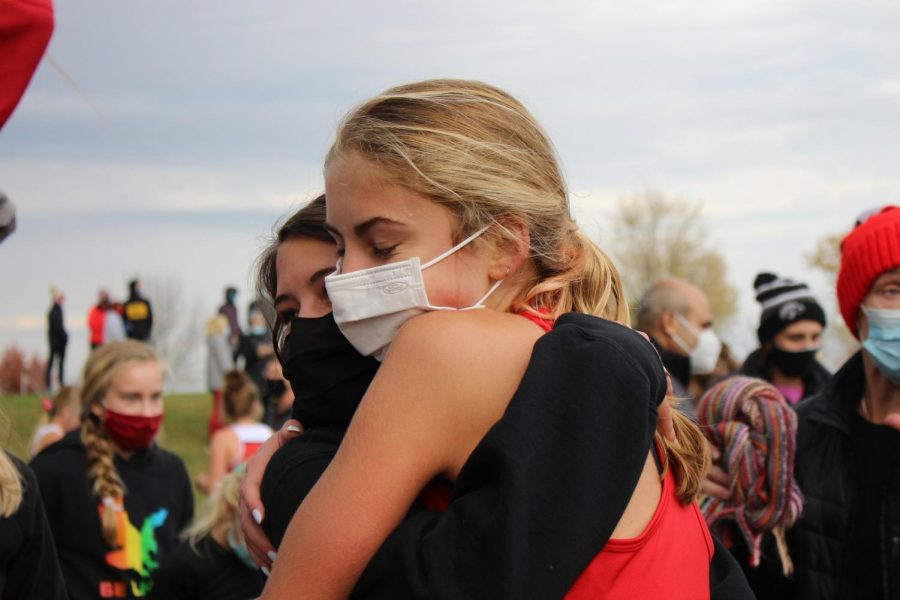 Rowan Boulter '22 hugs Janie Perrill '21 after the conclusion of the girls varsity race.