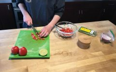 Lily Vanderlinden '21 chops up tomatoes for a salsa recipe.