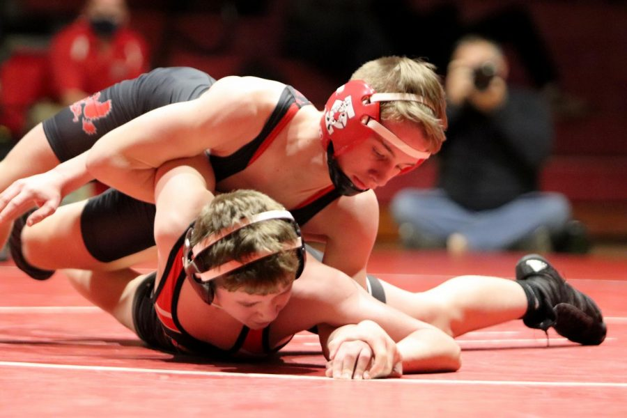 Cale Seaton '24 wrestles against a Cedar Falls opponent during City's 40-29 dual meet win.