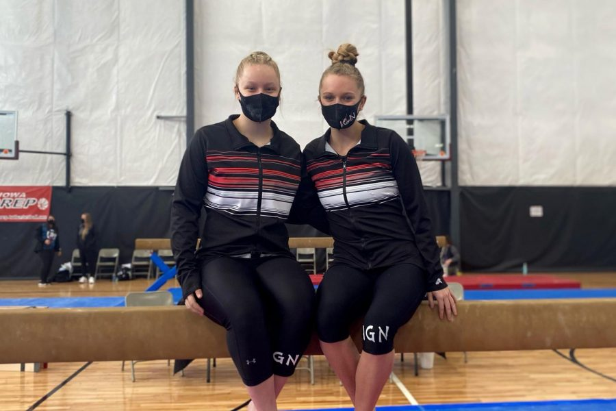 Natalie Green '21 and Jordan Sekafetz '21 posing on a beam during their senior year of gymnastics.