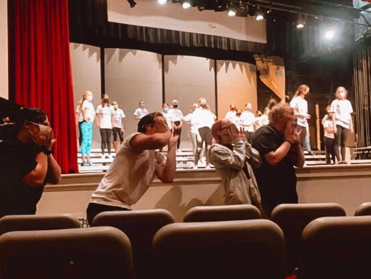 Senior members of Fourth Avenue Jazz Company cheer on junior varsity Charisma during their rehearsal.