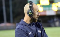 New City High head football coach Mitch Moore coaches a game for Des Moines Roosevelt.
