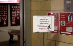 A social distancing sign sits outside the City High Attendance Office. The attendance office will begin calling students guardians for unexcused absence.