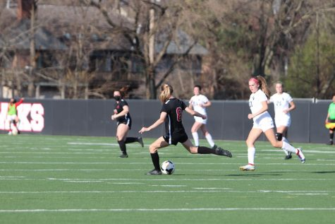 Girls varsity player #8 Aoife Boulter kicks the ball in their game against PV.