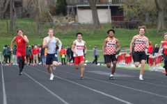 Mengty Tan '22 runs the open 100m. He finished 13th with a time of 12.03