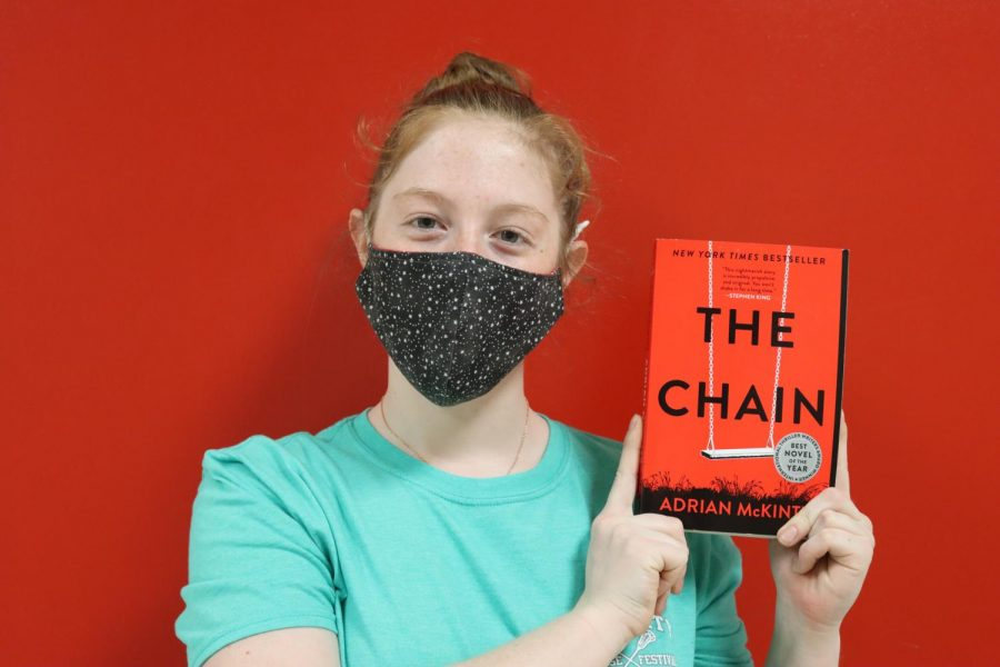 Kate Kueter '21 holds 'The Chain'.