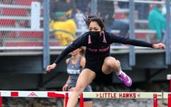 Maya Morales '21 running the second leg of The Shuttle Hurdle relay.