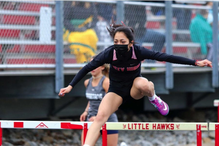 Maya Morales 21 running the second leg of The Shuttle Hurdle relay.