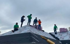 Flores Construction crew working to roof a house