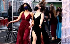 Nicole Day '21 and Laila Butler-Mills '21 walk down the red carpet at