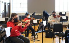 Jennie Gidal '23 (left) attends an in-person orchestra rehearsal