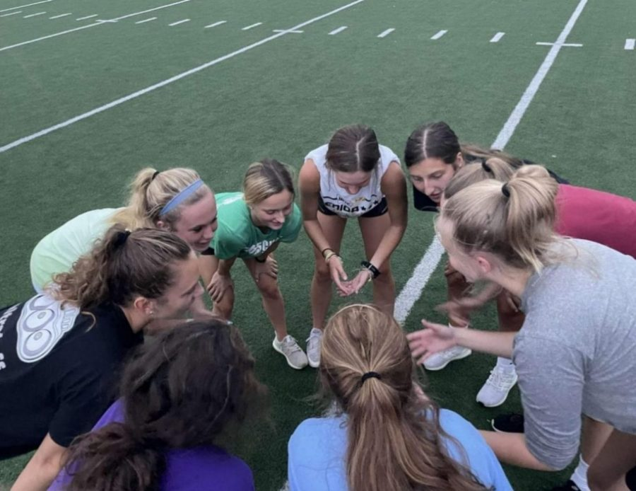 Smack that Pass team huddles during practice.