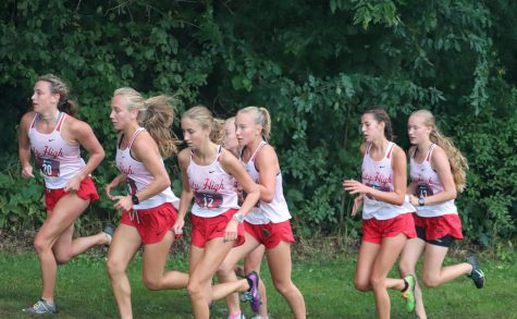 City High Girls Varsity strides together on their first race of the season.