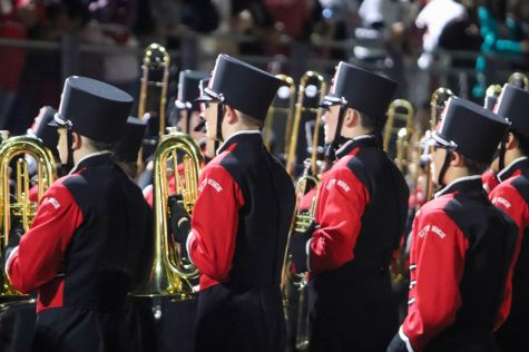 The trombone section of the City High Marching Band prepares to perform.