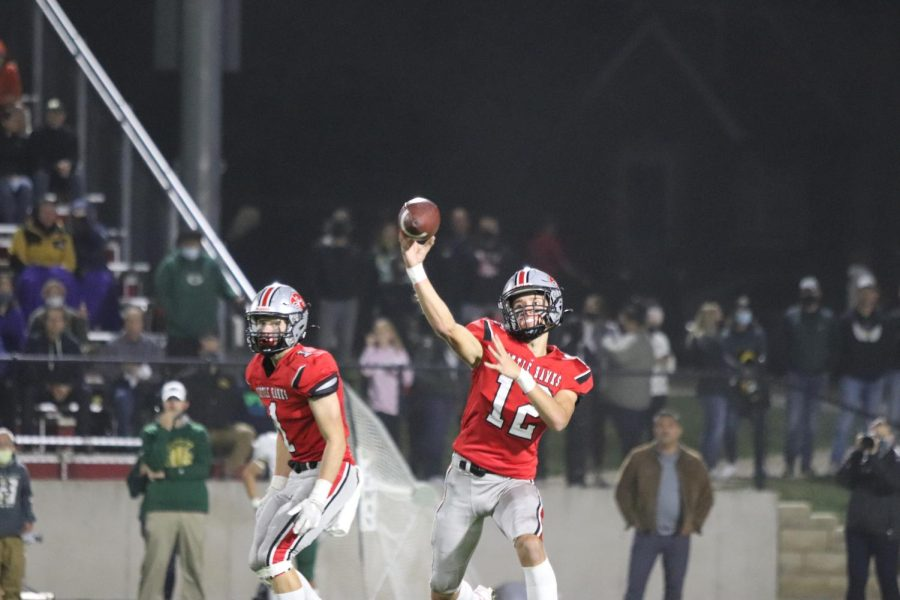 Drew Larson 24 Throws a deep ball against West high during the Battle for the Boot