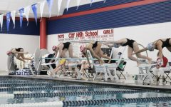 City High swimmers dive into the water at their meet against Linn-Mar.