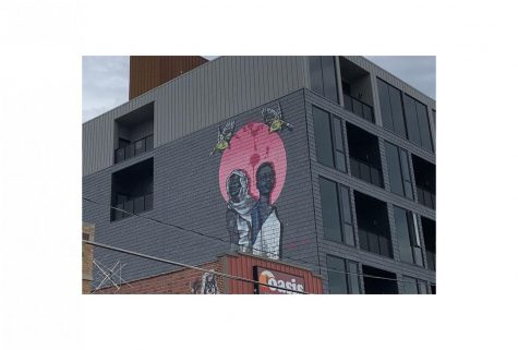 """Found on 202 N. Linn Street, this mural was painted in June of 2020 by artists Robert Moore and Dana Harrison. """"There's a lot of Black humans and community figures in Iowa City that I wanted to elevate,"""" Moore told the Daily Iowan."""