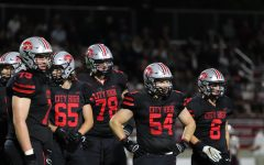 City High offensive line looks back at the coaches before the play.
